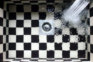 checkered sink filling up with water
